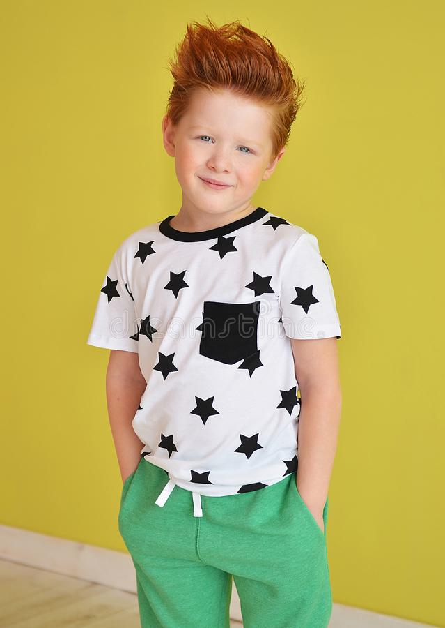 Portrait of red-haired naughty boy looking at the camera. Cute a royalty free stock images
