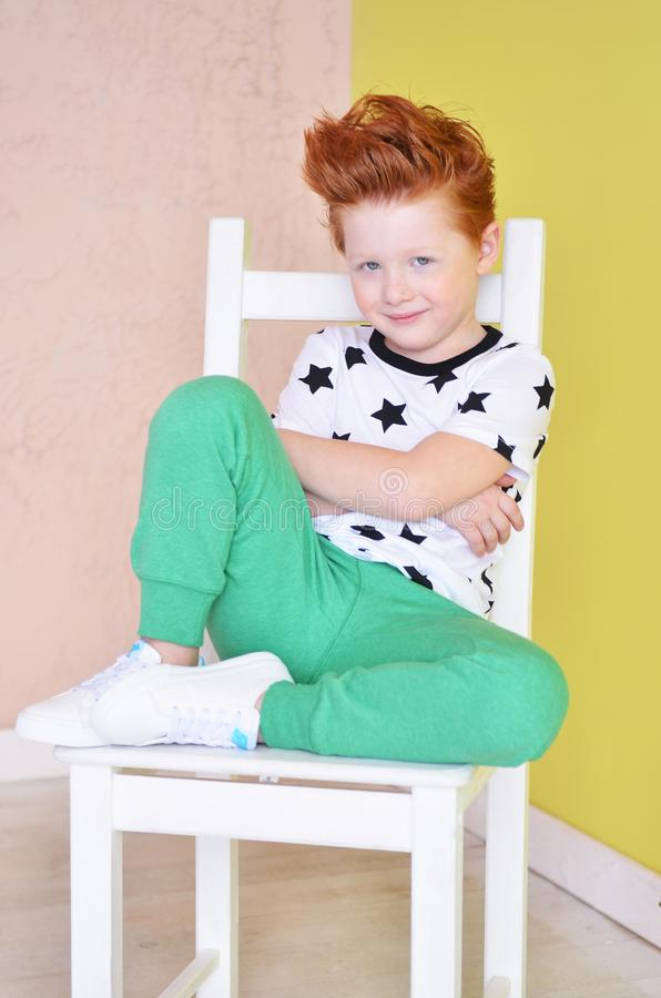 Portrait of red-haired naughty boy looking at the camera. Cute a royalty free stock photo