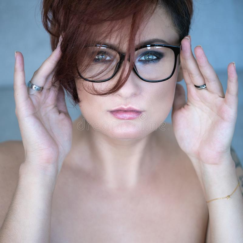 Portrait of red-haired woman royalty free stock photography