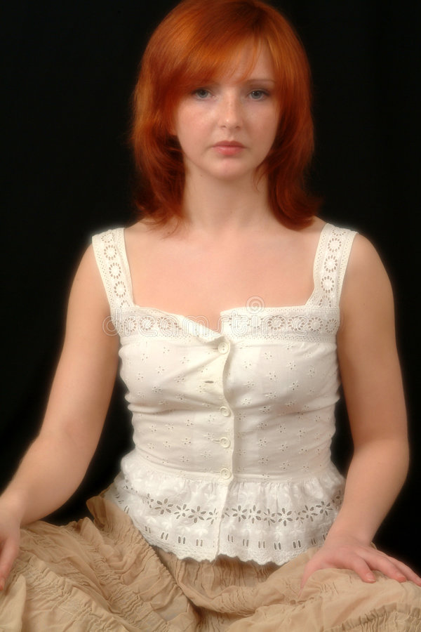 Portrait Of Red Head In White Blouse stock images