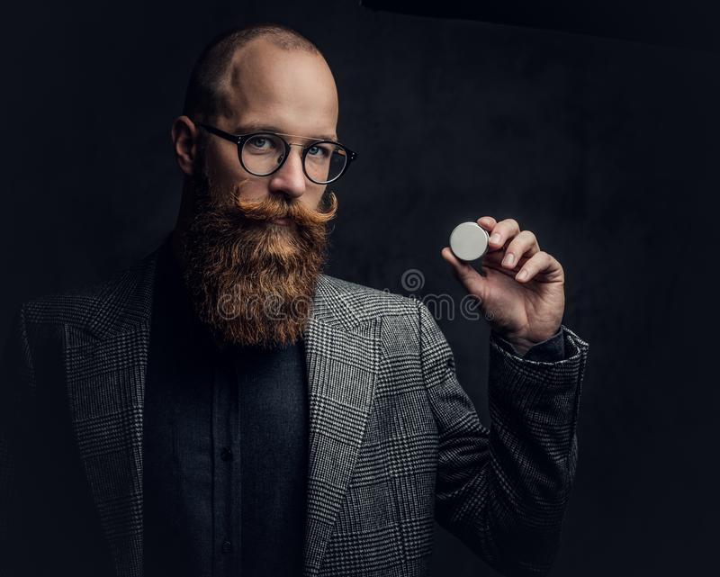 Redhead bearded male in a suit. royalty free stock photo