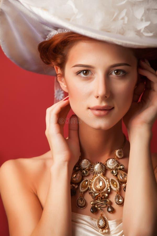 Portrait of redhead edwardian women. Portrait of redhead edwardian woman with necklace on red background royalty free stock photos
