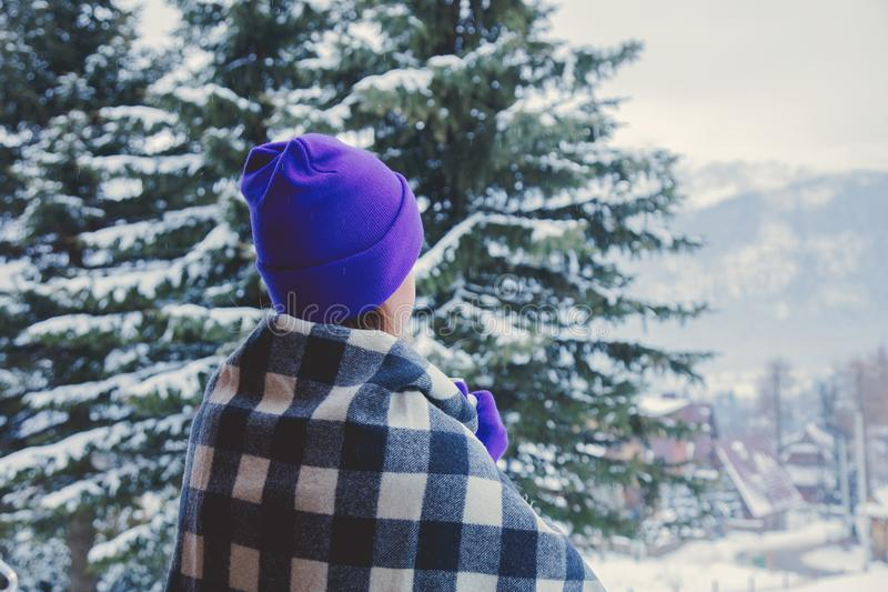 Portrait of redhead girl in plaid and purple hat with cup. Of hot drink at winter outdoor stock images