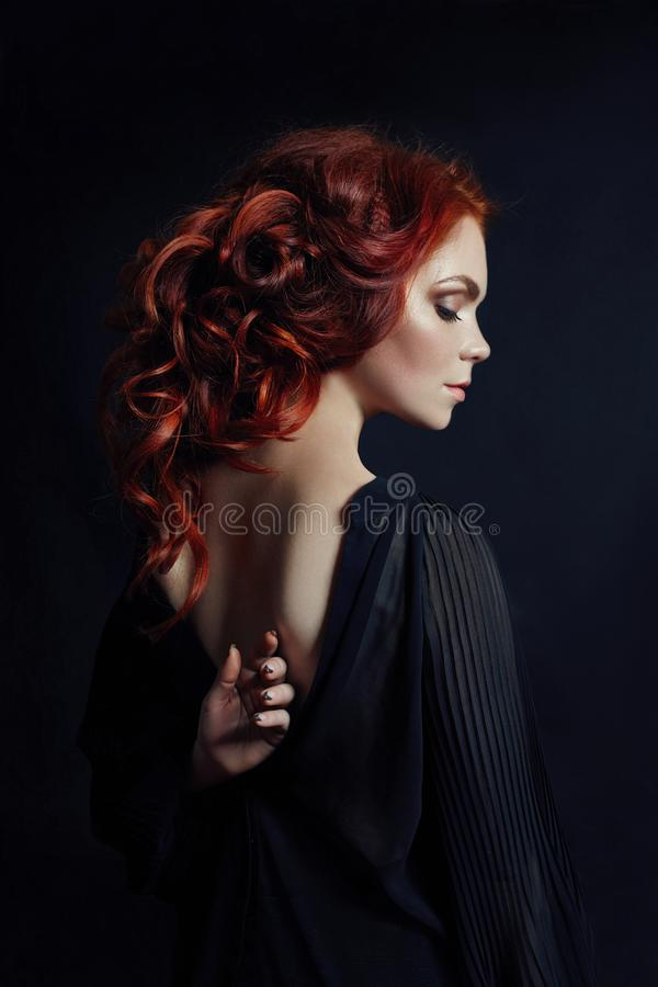 Portrait of redhead woman with long hair on black background. Perfect girl with the blue eyes, nice clean skin. Beautiful natural makeup, red hair stock image