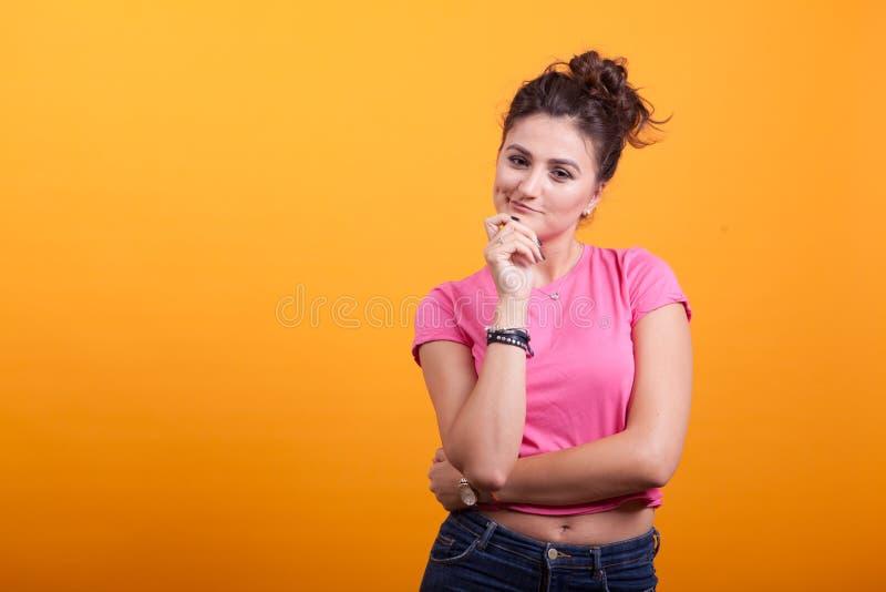 Portrait of reflective beautiful woman wondering royalty free stock photography