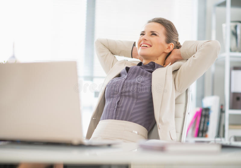 Portrait of relaxed business woman in office royalty free stock photography