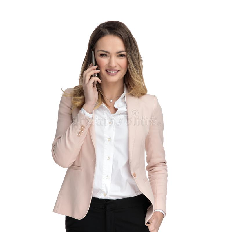 Portrait of relaxed businesswoman talking on the phone stock photo