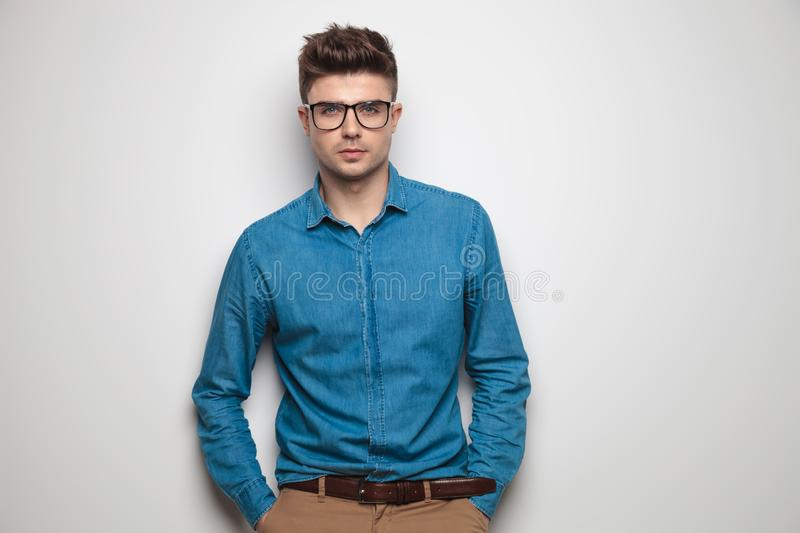 Portrait of relaxed casual man wearing sunglasses and blue shirt royalty free stock photography
