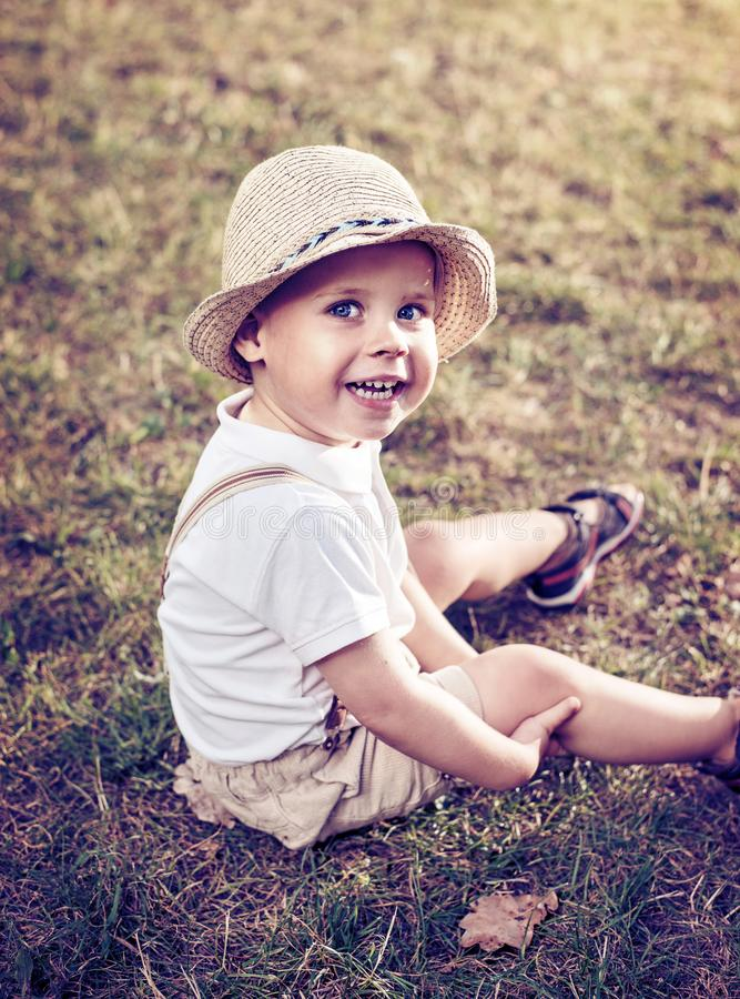 Portrait of a relaxed, cheerful child stock photo