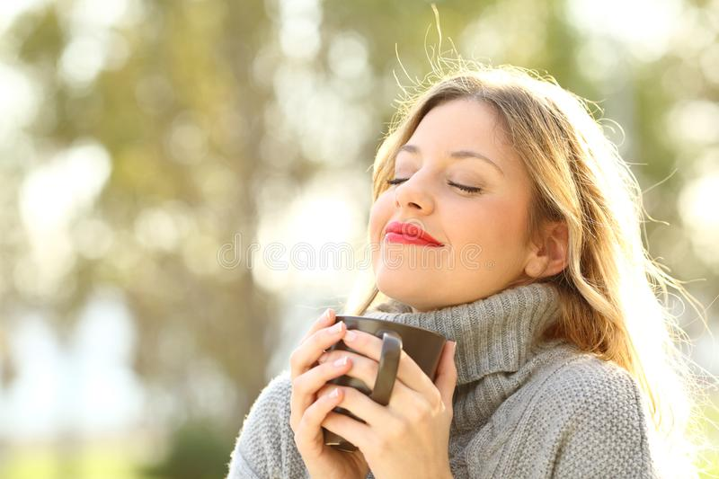 Relaxed girl breathing outdoors in winter stock photography