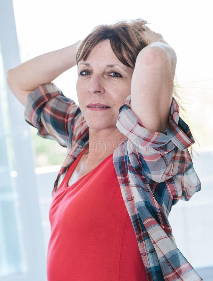 Portrait of relaxed mature woman royalty free stock images