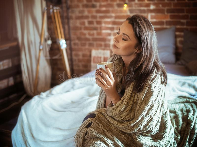 Portrait of a relaxed lady drinking coffee stock images