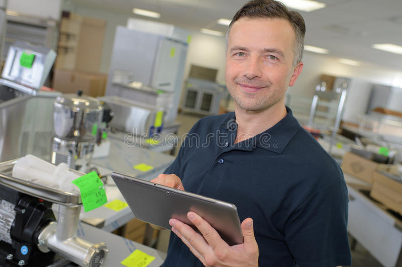 Portrait retailer with tablet. Portrait of retailer with tablet stock photography