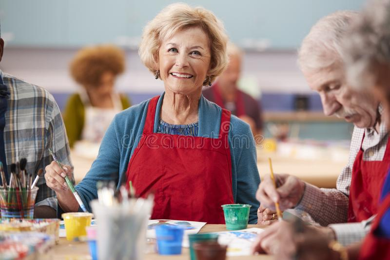 Portrait Of Retired Senior Woman Attending Art Class In Community Centre royalty free stock photography