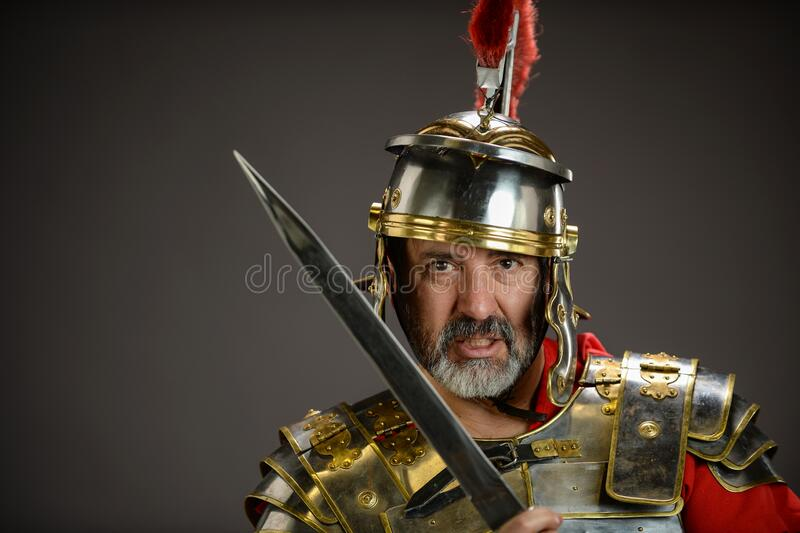 Roman soldier holding his sword stock photography