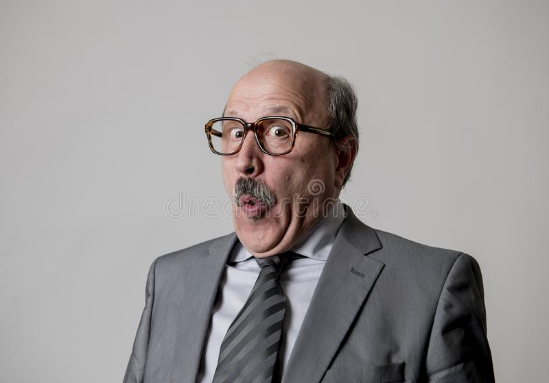 Portrait of 60s bald senior happy business man gesturing funny and comic in laughter and fun face expression looking happy royalty free stock photos