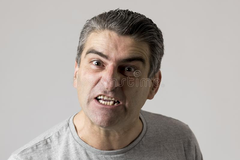 Portrait of 40s to 50s white angry and upset guy and crazy furious and aggressive face expression nagging and complaining royalty free stock image