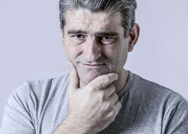Portrait of 40s to 50s sad and worried man looking frustrated an stock photography
