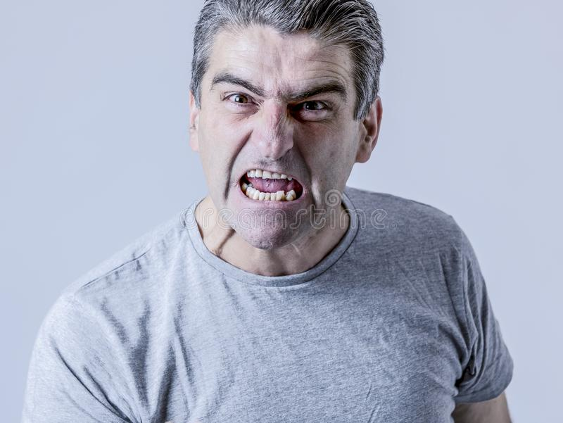 portrait of 40s to 50s white angry and upset guy and crazy furious and aggressive face expression nagging and complaining royalty free stock photo