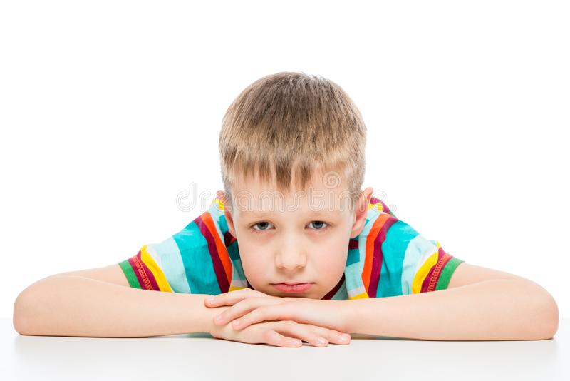 Portrait of a sad boy of 10 years on white background stock images