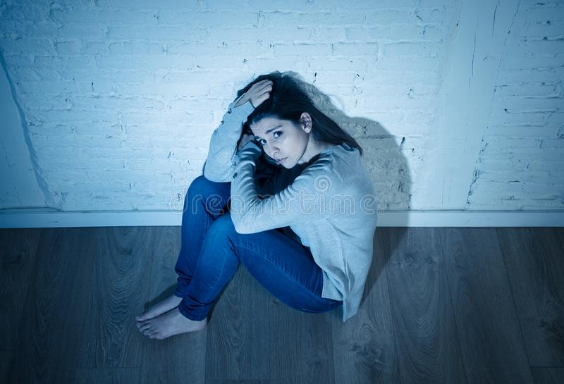 Portrait of sad depressed young woman feeling distressed alone at home in mental health concept. Portrait of young desperate latin woman feeling miserable stock images