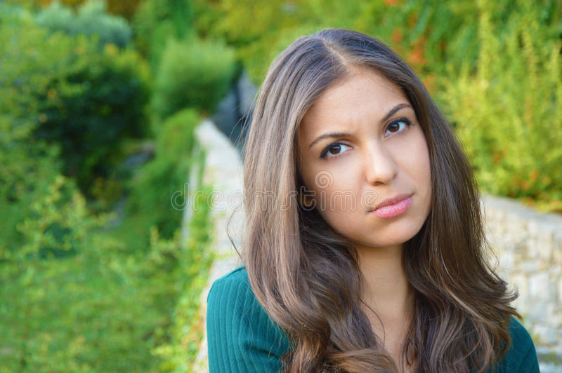 Portrait of a sad girl looking at camera outdoor royalty free stock image