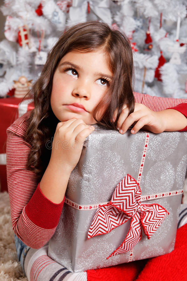 Portrait of a sad little girl at Christmas royalty free stock images
