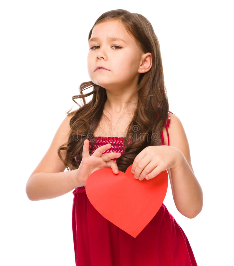 Portrait of a sad little girl in red royalty free stock image