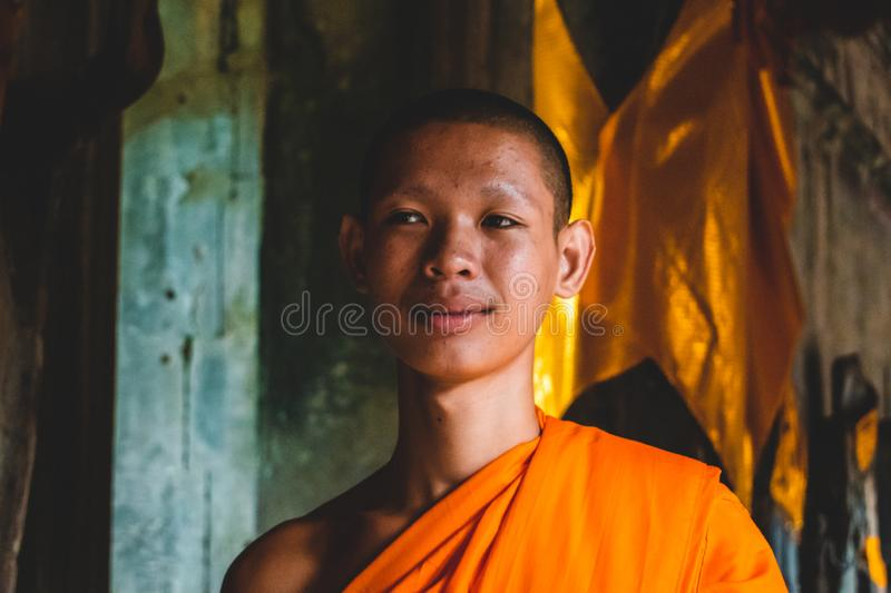 A portrait of a monk inside the Temples of Angkor Wat stock image