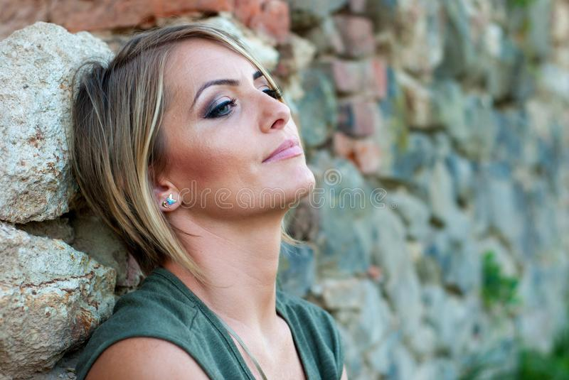 Portrait of a sad, moody blonde woman royalty free stock image