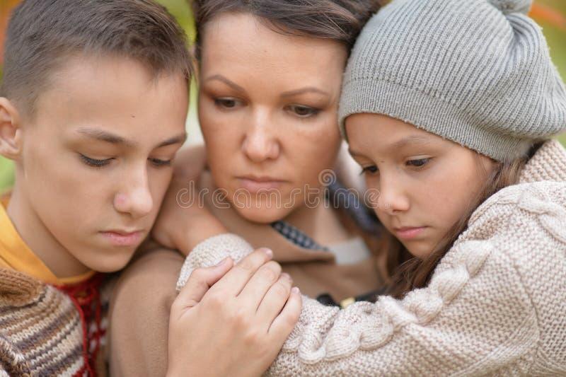 Sad mother and children stock photo