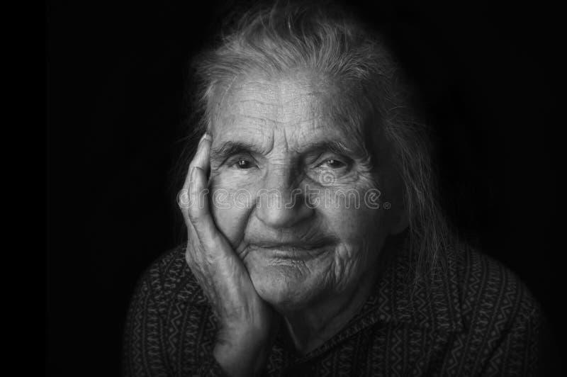 Portrait of a nostalgic elderly woman. Evoking the past. royalty free stock photos
