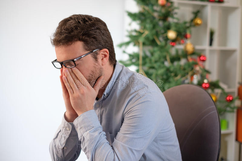 Portrait of sad office collar worker during christmas holiday ti. Me sadness royalty free stock images
