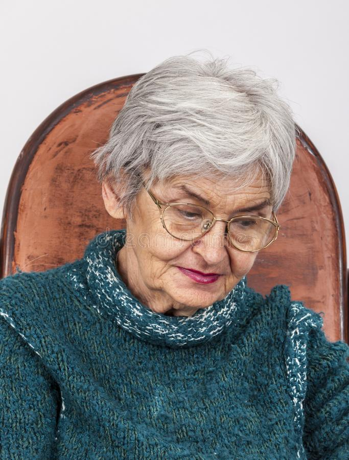 Portrait of a Sad Old Woman. With glasses royalty free stock photo