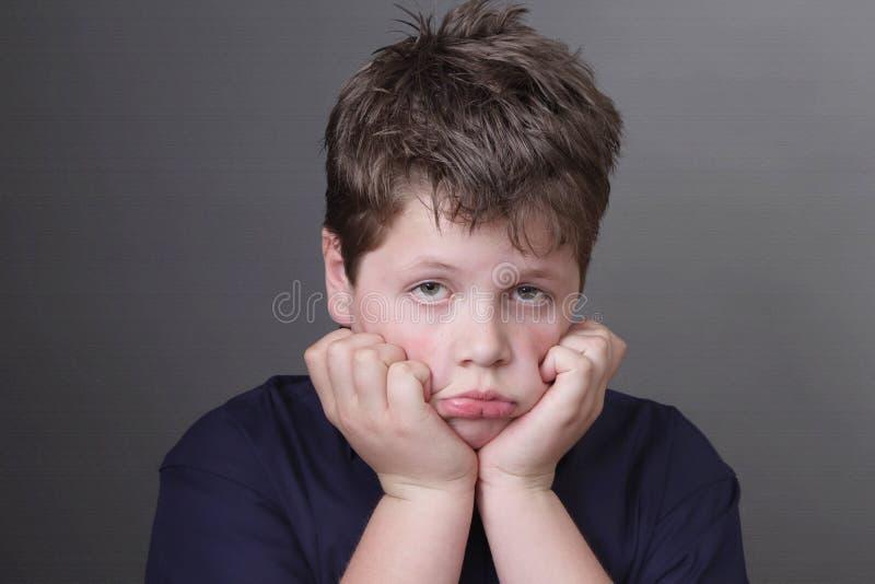 Portrait of sad overweight boy stock photos