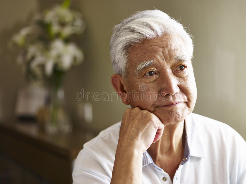 Portrait of a sad senior asian man royalty free stock photos