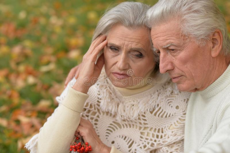 Close up portrait of sad senior couple stock images
