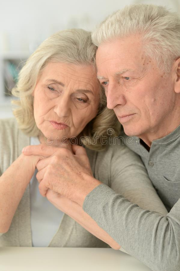 Portrait of sad senior couple posing at home royalty free stock image