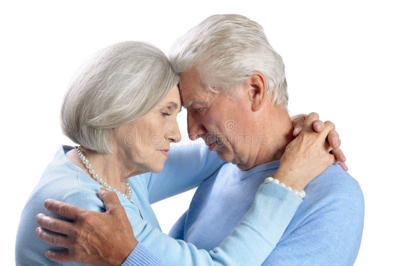 Portrait of sad senior couple on white background. Portrait of sad senior couple isolated on white background royalty free stock image