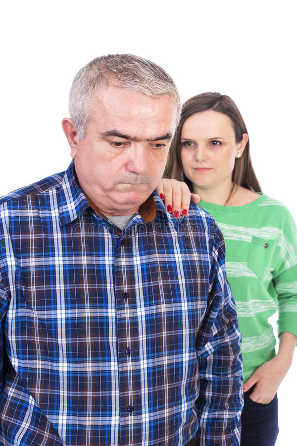 Portrait of sad senior man being comforted by his daughter. Portrait of sad senior men being comforted by his daughter against white background royalty free stock photo