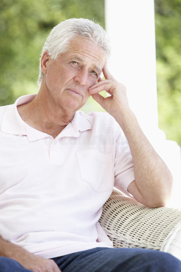 Portrait Of Sad Senior Man Relaxing In Chair stock photos