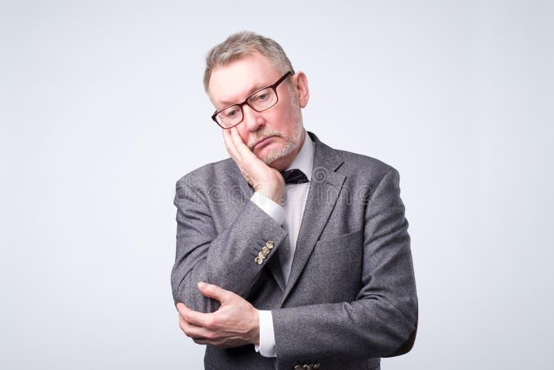 Portrait of sad senior man.Sad senior man stock photo