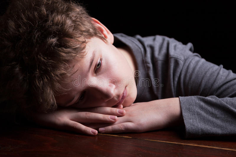 Sad teenage boy stock photos