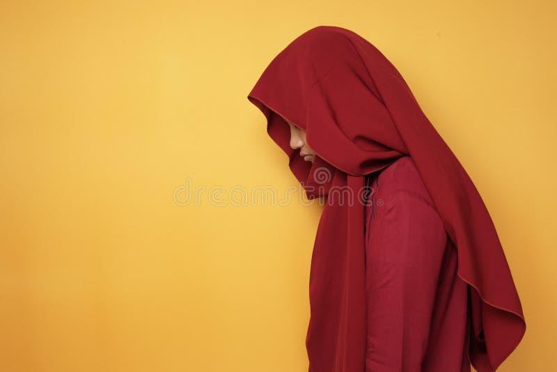 Sad Asian Teenage Muslim Girl Looking Down royalty free stock image