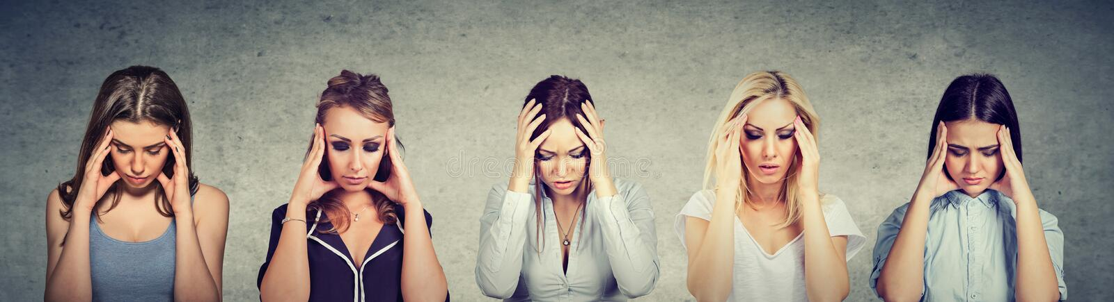 Portrait of sad young beautiful women looking down royalty free stock images