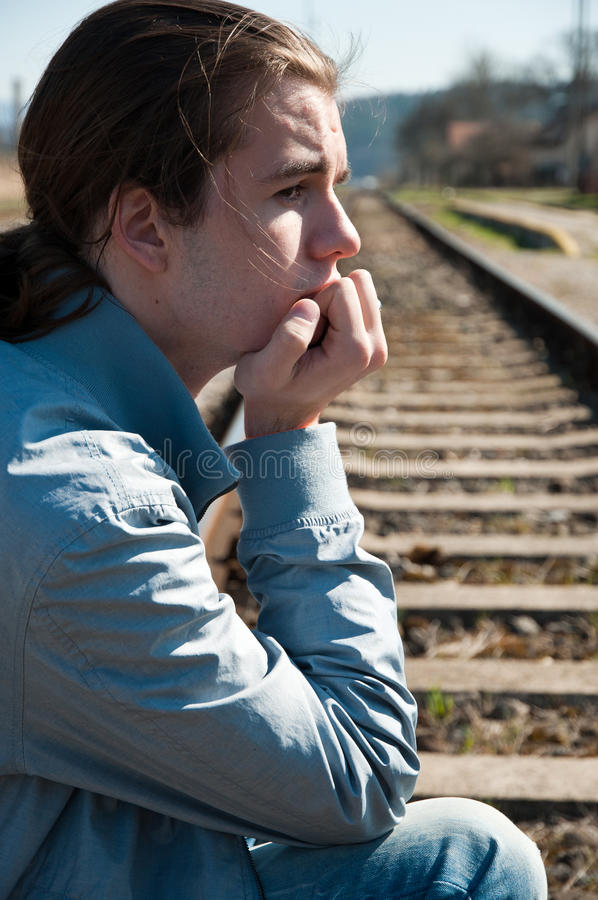Download Portrait of sad young man stock image. Image of railway - 24463413