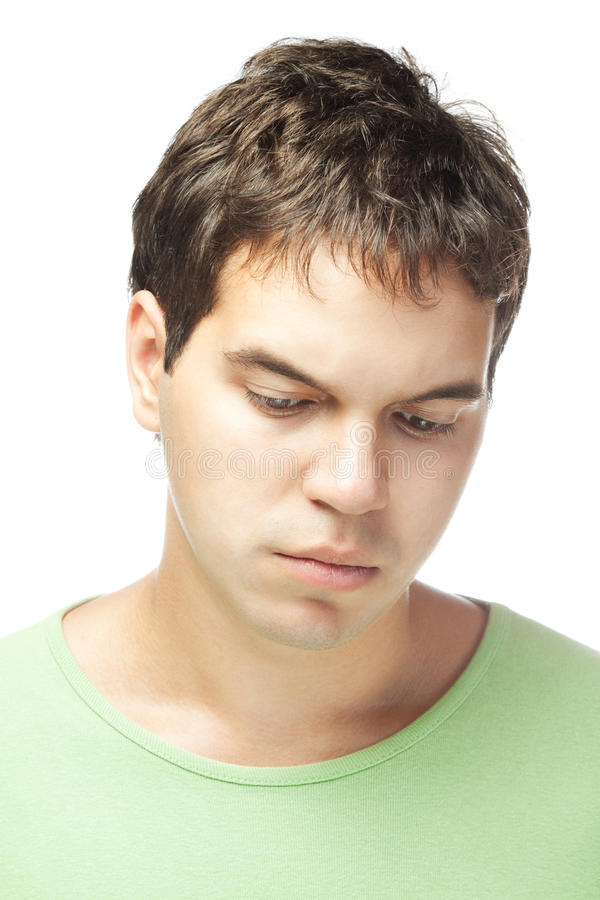 Portrait of sad young man isolated on white stock photography