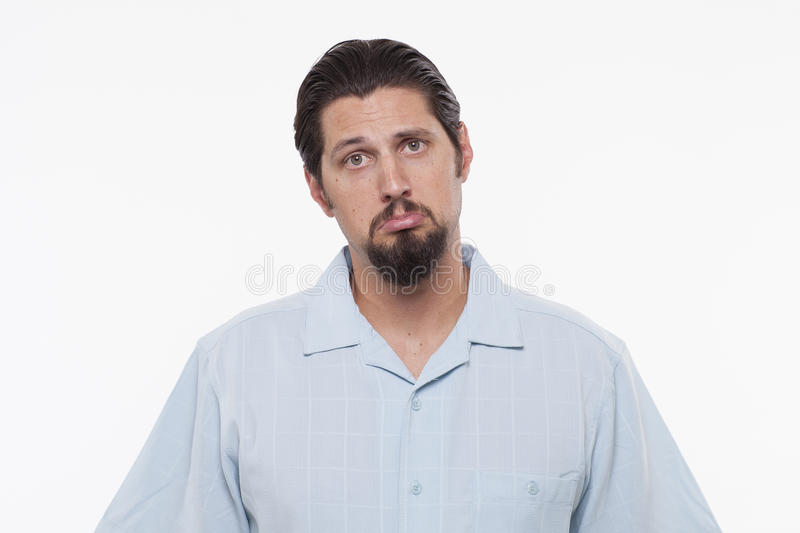 Portrait of a sad young man standing against white royalty free stock photo