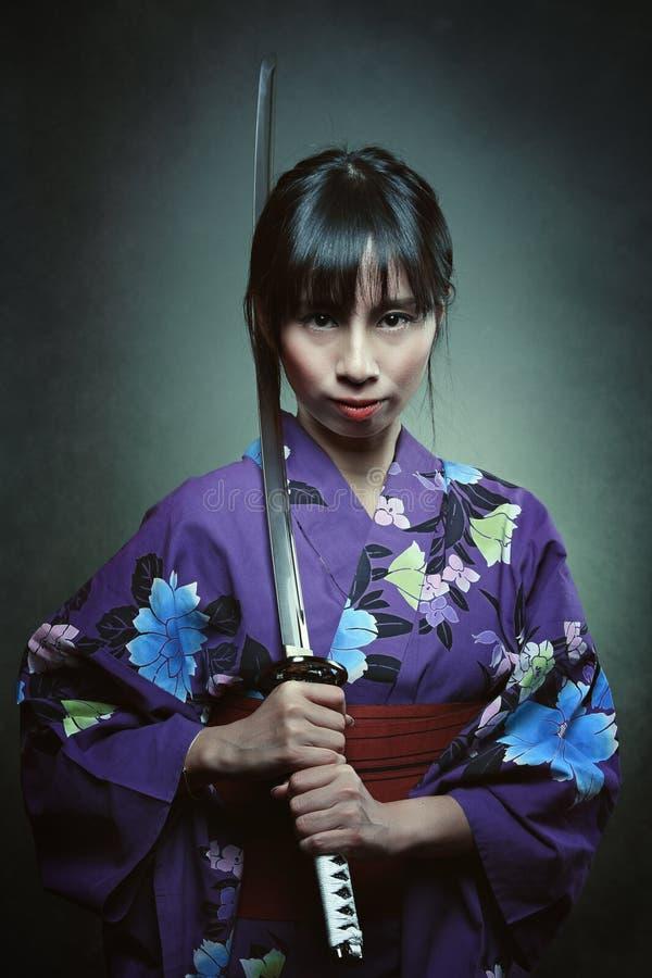 Portrait of a samurai woman royalty free stock image