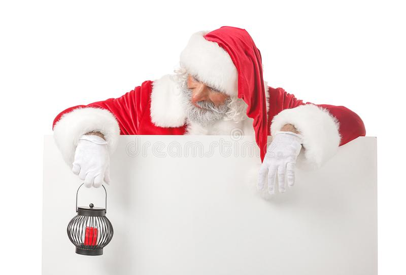 Portrait of Santa Claus with blank poster and lantern on white background royalty free stock photography